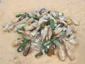 a terrifying amount of glass now lay beneath the sand, as so few places to throw bottles were provided above