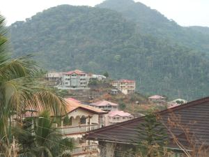 Freetown has more half-finished mansions than any city we have yet passed through