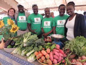 The peerless display of organic veg grown on the Taaru Askan farm by Nicole and Mamadou (left)