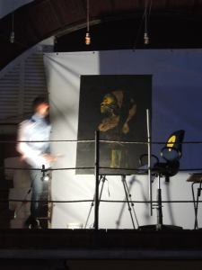 but more than the live painting happening on the balcony...