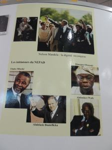 Presidents Mbeki, Obesanjo, Bouteflicka and Wade are lauded inside as the initiators of NEPAD...