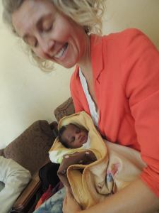 Newborn baby Oumar was brought out to meet us, dressed in yellow, his curls oiled...